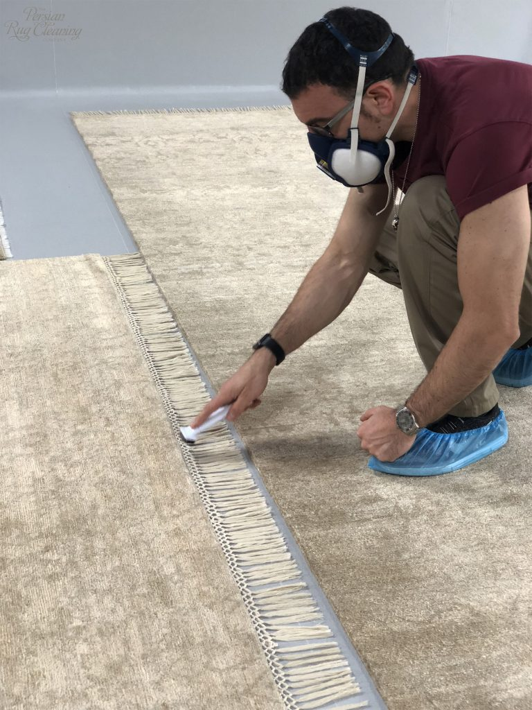 Applying rug protector treatment to silk rug